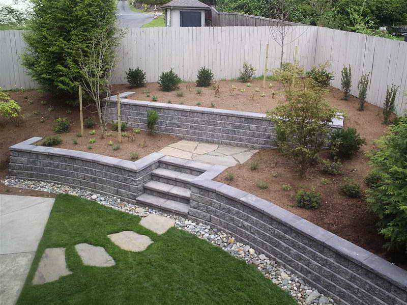 A barragan wood fencing Cinder block retaining wall